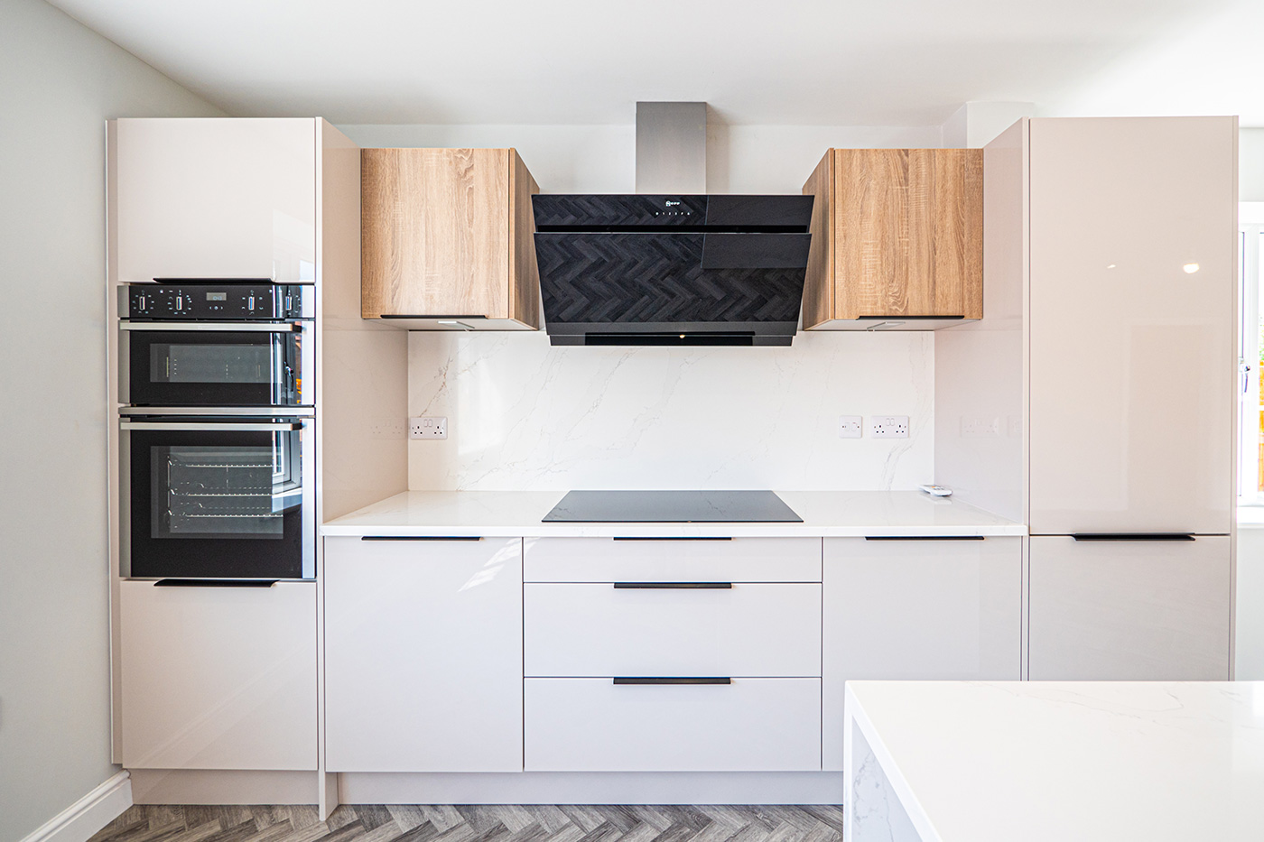 White kitchen units with integrated oven