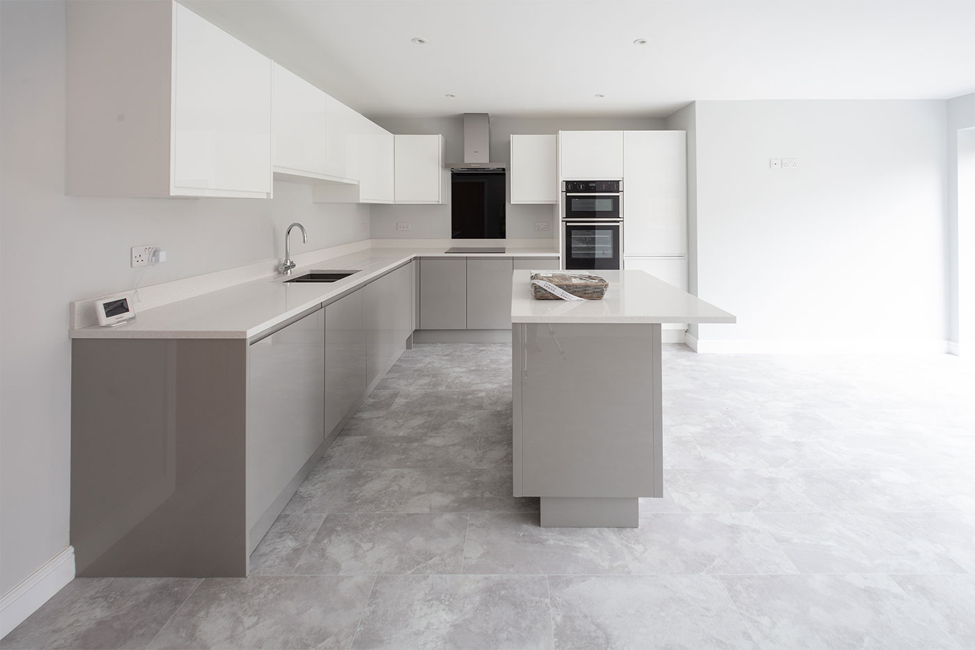 A grey and white modern fitted kitchen